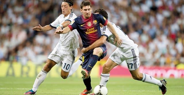 Liga : Le Barca et le Real dos à dos