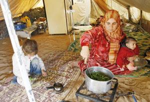 Un an après l'invasion israélienne : Gaza survit dans les ruines