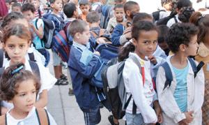 Un million de cartables aux élèves nécessiteux