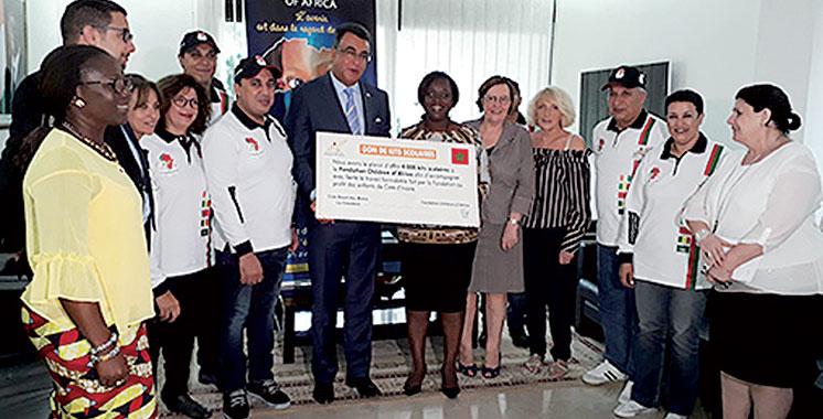 Action solidaire : Le Club Royal des motos fait don à Abidjan de 4.000 kits scolaires à «Children of Africa»